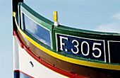 Local fishing boats or Luzzu, decorated with Osiris eyes for good luck. Marsaxlokk. Malta.