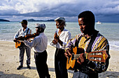 Wedding celebrated on the Achipiel Hotel beach with local musicians. Praslin Island. Seychelles