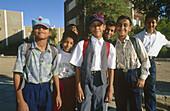 Schoolboys in uniform, Kharga Oasis. Lybian desert, Egypt