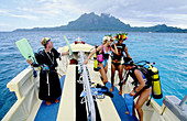 Funny undermarine wedding to be celebrated for professional divers. Bora Bora. Leeward islands. Society archipelago. French Polynesia (model released)