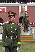 Soldiers stand guard in front of Gate of Heavenly Peace to the Forbbiden City, Tiananmen Square. Beijing. China