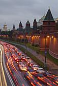 Moscow, Russia, Kremlevskaya Nab, Kremlin Walls, Neva River, at twilight, with traffic, rush hour, car light streaks.