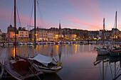 After sunset at the harbour of Honfleur, dept. Calvados, Normandie, France, Europe