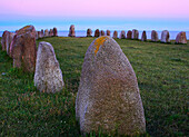 Ales stenar biggest old stone circle in form of a ship in Scandinavia near Kaseberga after sunset, Skane, Sweden