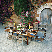 Table and chairs in a courtyard.
