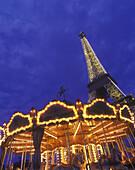 Merry-go-round, Eiffel tower, Paris, France.