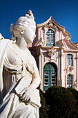 Queluz, Portugal: Classical female figure in the French-style formal gardens of the Palacio Nacional de Queluz. The Queluz Palace, an example of the rococo in Portugal, was constructed between 1747 and 1787. Note Palace in background.