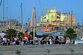 Outdoor cafe on waterfront and Gothic cathedral in background. Palma de Mallorca. Majorca, Balearic Islands. Spain