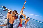 Adult, Adults, Beach, Beaches, Best friends, Board, Boards, Boy, Boys, Caucasian, Caucasians, Close friend, Close friends, Coast, Coastal, Collaboration, Color, Colour, Companion, Companions, Companionship, Contemporary, Cooperation, Daytime, Emotion, Em