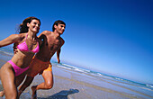 Activity, Adult, Adults, Affection, Amusement, Bathing suit, Bathing suits, Beach, Beaches, Bikini, Bikinis, Blue, Blue sky, Carefree, Caucasian, Caucasians, Coast, Coastal, Color, Colour, Contemporary, Couple, Couples, Daytime, Enthusiasm, Exhuberant, E