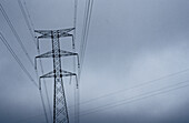 Color, Colour, Concept, Concepts, Daytime, Detail, Details, Electricity, Energy, Exterior, Gray, Grey, Height, Horizontal, Hydroelectric energy, Industrial, Industry, One, Outdoor, Outdoors, Outside, Power, Power line, Power lines, Pylon, Pylons, Skies,