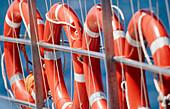 Banister, Banisters, Boat, Boats, Color, Colour, Concept, Concepts, Daytime, Detail, Details, Exterior, Float, Floats, Four, Four items, Handrail, Handrails, Horizontal, Life belt, Life belts, Life preserver, Life preservers, Lifebelt, Lifebelts, Navigat
