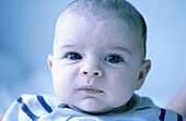 7 to 12 months, 7-12 months, Babies, Baby, Caucasian, Child, Childhood, Children, Close up, Close-up, Color, Colour, Contemporary, Face, Faces, Horizontal, Human, Indoor, Indoors, Infant, Infants, Inside, Interior, Looking at camera, One, One person, Peo