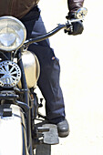 Adult, Adults, Bike, Biker, Bikers, Bikes, Color, Colour, Contemporary, Cycle, Cycles, Daytime, Detail, Details, Exciting, Exterior, Half, Halves, Human, Individualism, Individualist, Leg, Legs, Leisure, Motorbike, Motorbikes, Motorcycle, Motorcycles, Mo