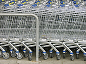 Alignment, Arrangement, Capitalism, Cart, Carts, Color, Colour, Commerce, Concept, Concepts, Consumption, Continuity, Detail, Details, Economy, Exterior, Fit, Fitting, Floor, Horizontal, Hypermarket, Hypermarkets, Line, Lines, Many, Metal, Order, Outdoor