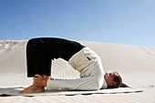Adult, Adults, Balance, Beach, Beaches, Bend, Bending, Bent, Black, Blonde, Blue, Body, Calisthenics, Callisthenics, Caucasian, Caucasians, Coast, Coastal, Color, Colour, Day, Daylight, Daytime, Difficult, Difficulty, Dune, Effort, Efforts, Equilibrium,