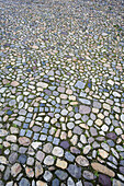 Background, Backgrounds, Cobble, Cobbles, Coblestone, Coblestones, Color, Colour, Concept, Concepts, Construction, Exterior, Geometry, Gray, Grey, Ground, Grounds, Hard, Hardness, Outdoor, Outdoors, Outside, Pattern, Patterns, Paving stone, Stone, Surfac