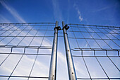 Access, Barrier, Blockade, Blue, Blue sky, Close up, Close-up, Closed, Closeup, Color, Colour, Concept, Concepts, Daytime, Detail, Details, Exterior, Fence, Fences, Frustrate, Frustration, Hindrance, Horizontal, Hurdle, Impediment, Locked, Low angle view