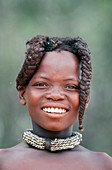 Himba girl with the typicl double plait hairstyle of the pre-adolescent girls. Kaokoland. Namibia