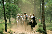During Pentecost some pilgrims cover on horseback a three days journey through Doñana National Park to El Rocío. Huelva province. Andalusia. Spain