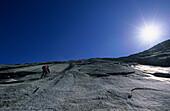 Climber on granite slab, Klein Furkahorn, Urner Alps, Canton of Uri, Switzerland