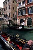 Canal with bridge and boats (gondolas), Venice, Venezia, Italy