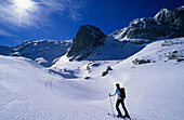 Backcountry skier ascending Alpltal to Hoher Goll, Berchtesgaden Alps, Upper Bavaria, Bavaria, Germany