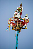 Voladores (flyers) perform Totonac Native ritual outside of Tulum. Yucatan, Mexico