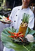 Cheff with local cuisine, Hilton Batang National Park. Sarawak. Borneo. Malaysia