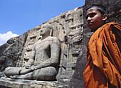 Buddhist child at Gal Vihara temple (built in the 12th century), Polonnaruwa. Sri Lanka