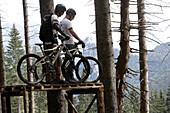 Two men riding their Mountainbikes, Oberammergau, Bavaria, Germany