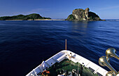 Cruise ship, MV Reef Escape approaching Navadra Island, Mamanuca group, Fiji, South Sea