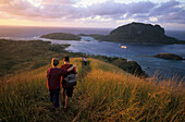 Two people enjoying the view, Hiking, view from Yasawa Island over Blue Lagoon to Sawa-i-Lau, Yasawa group, Fiji, South Sea