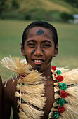 Traditionally clothed young local boy in Naboro village on Waya Sewa Island, Yasawa group, Fiji, South Sea
