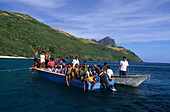 A school boat with children in Octopus Bay off Waya Island, Yasawa group, Fiji, Südsee