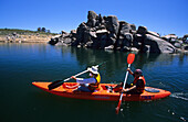Two people kayaking on Lake Jindabyne at the foot of the Snowy Mountains, Kosciuszko National Park, New South Wales, Australia