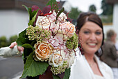 Bride with bridal bouquet, Hauneck, Hesse, Germany