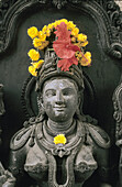 Heavenly nymph with flower offerings, India