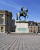 Equestrian statue of Louis XIV in front of palace. Versailles. France