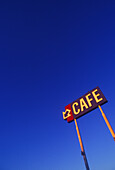 Arrow, Arrows, Blue, Blue sky, Cafe, Cafes, Coffee, Coffee shop, Coffee shops, Color, Colour, Concept, Concepts, Daytime, Detail, Details, Direction, Exterior, Information, Low angle view, Outdoor, Outdoors, Outside, Sign, Signs, Skies, Sky, Vertical, Vi