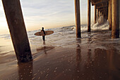 Adult, Adults, Alone, Beach, Beaches, Board, Boards, Carry, Carrying, Coast, Coastal, Color, Colour, Contemporary, Daytime, Dock, Docks, Evening, Exterior, Full-body, Full-length, Horizontal, Human, One, One person, Outdoor, Outdoors, Outside, People, Pe