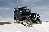 Lawson s converted Jeep using Mattracks instead of tires to off-road near Cape Merry, Churchill, Manitoba, Canada.