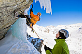Two persons ice climbing at Corn Diavolezza (man-made icefall), Pontresina, Upper Engadin, Grisons, Switzerland