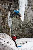 Two persons ice climbing in a gorge, Pontresina, Upper Engadin, Grisons, Switzerland