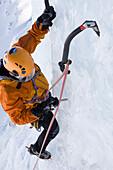 Man ice climbing at Corn Diavolezza (man-made icefall), Pontresina, Upper Engadin, Grisons, Switzerland