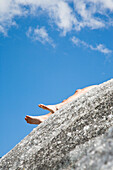 Naked person lying on Aletsch Glacier, Valais, Switzerland