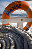Close up of a coil of rope and a life buoy, a personal floatation device, Shetland Islands, Scotland, Great Britain
