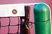 Close up, Close-up, Closeup, Color, Colour, Concept, Concepts, Daytime, Detail, Details, Exterior, Horizontal, Metal, Metallic, Net, Nets, Outdoor, Outdoors, Outside, Pole, Poles, Safety, Security, Tennis, Tied, Water, Wet, C71-236710, agefotostock