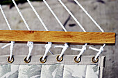 Close up, Close-up, Closeup, Color, Colour, Concept, Concepts, Cord, Cords, Daytime, Detail, Details, Exterior, Hammock, Hammocks, Hang, Hanging, Horizontal, Outdoor, Outdoors, Outside, Row, Safety, Security, String, Strings, C71-266644, agefotostock