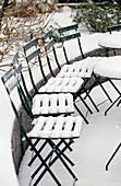 Chair, Chairs, Cold, Color, Colour, Concept, Concepts, Covered, Exterior, Nobody, Outdoor, Outdoors, Outside, Park, Parks, Snow, Table, Tables, Vertical, Weather, White, Winter, Wintertime, C71-268420, agefotostock